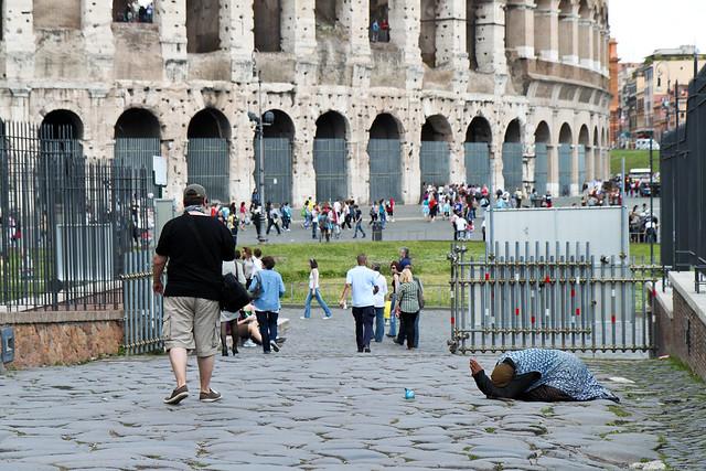 Rome. Coliseum beggar