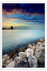 Shuwaikh Sunset (Hussain Shah.) Tags: city sunset sea beach clouds d50 nikon rocks sigma shore kuwait 1020mm shuwaikh cokin gnd abigfave aplusphoto