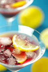 Cheers (2/3) (Thorsten (TK)) Tags: blue red party stilllife food ice glass yellow catchycolors lemon drink beverage sunny fluid cocktail alcohol vodka syrup beverages styling grenadine foodphotography foodstyling thorstenkraska
