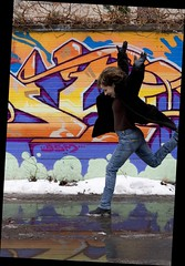 leap of faith (torontofotobug) Tags: puddle jump rachel alley january graffitti vistor