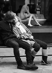 Feeling at home (Itzick) Tags: bw love bench couple romance lovers d200 youngwoman youngman golddragon goldenphotographer