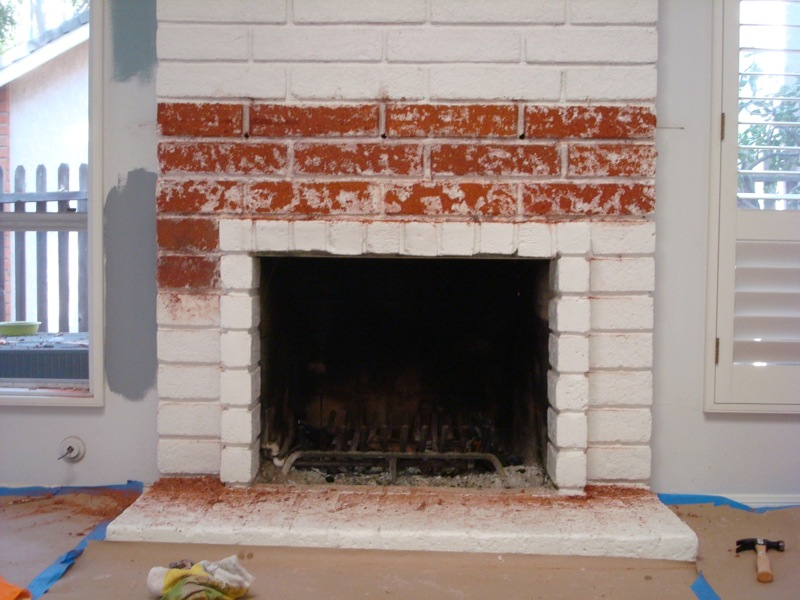 The two largest crimes in this house were the decision to paint both the brick fireplace and the beautiful wood plank ceiling WHITE. My first two goals when we bought the house were to find someway to strip the fireplace to it