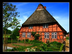 farmhouse / Molfsee / Germany (unicorn 81) Tags: old roof red house color building rot history architecture farmhouse germany deutschland countryside colorful europa europe village cottage eu haus thatch thatchedroof openairmuseum freilichtmuseum ferme germania schleswigholstein ih thatched countryhouse cottages fachwerk casadecampo colombages fachwerkhaus norddeutschland thatchedcottage halftimber mapgermany bauernhaus reetdach northerngermany timberedhouse thatchedhouse molfsee niemcy saksa views100 casacolonica friluftsmuseet reetdachhaus thatchedroofcottages ruralhouses musedepleinair architekturdeutschland unicorn81  hausmitreetdach allemeinefotosvon001500 fachwerkbauhalftimberedbuilding