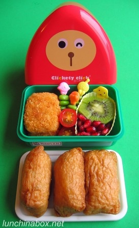 Triangular onigiri bento box lunch
