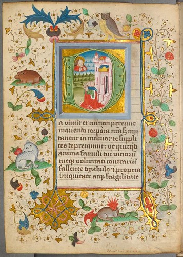 Illuminated letter with scenic infill, text and surrounds of stylised animals and decoration