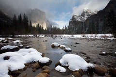 Gates of the Valley in Snow (Nick Carver Photography) Tags: california park travel trees winter usa cloud mountain snow storm mountains tree tourism nature water rock fog pine clouds river relax landscape outdoors landscapes rocks stormy calm boulder boulders alpine valley rivers serenity western serene yosemitenationalpark wilderness elcapitan sierranevada relaxed leaningtower bridalveilfalls valleyview yosemitevalley centralcalifornia mercedriver cathedralrocks clearingstorm wildlifereserve natureparks gatesofthevalley ncpfineartprint nationalparksystem