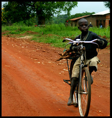 bicycle (LindsayStark) Tags: africa travel portrait war conflict uganda humanrights humanitarian displaced idpcamp refugeecamp idps idp humanitarianaid emergencyrelief idpcamps waraffected