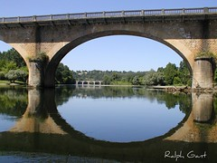 Road bridge over the Dordogne, France 2005 (ralph&dot (away for a bit)) Tags: 2005 road trip railroad bridge france water river photographer bridges rail railway dordogne canoe ponte trail ralph reflaction france2005 gant digitalcameraclub lebuissondecadouin 1on1reflections reflectedbridge