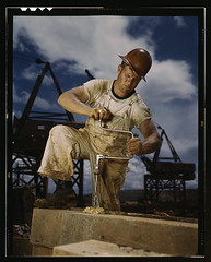 Carpenter at work on Douglas Dam, Tennessee (TVA)  (LOC) (The Library of Congress) Tags: hardhat color contrast work construction kodak crane tennessee wwii palmer daily dirty commute transparency overalls 4x5 worker libraryofcongress kodachrome hardwork brace tva drill carpenter bluecollar trabalhador borer pua seviercounty carpinteiro construo xmlns:dc=httppurlorgdcelements11 douglasdam dc:identifier=httphdllocgovlocpnpfsac1a35241 alfredtpalmer artofimages ourworkinglife