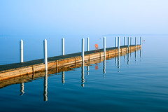 Sunday Morning Pier (Todd Klassy) Tags: morning travel blue sea summer vacation mist lake color reflection college uw water beauty horizontal fog wisconsin campus fun outdoors bay coast pier boat wooden seaside still dock haze chair memorial university terrace infinity seat horizon union shoreline foggy bluesky calm patio entertainment madison boating uwmadison sunburst recreation copyspace posts breeze universityofwisconsin wi lakefront clearsky linear stockphoto madisonwisconsin memorialunion studentunion lakemendota stockphotography colorimage memorialunionterrace hoofers reflectioninwater bodyofwater langdonstreet intothelake lakefrontproperty madisonphotographer cityofmadison toddklassy madisonlandscape summerinmadison