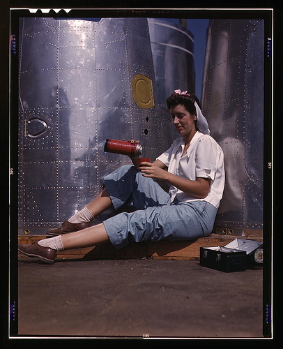 Girl worker at lunch also absorbing California sunshine, Douglas Aircraft Company, Long Beach, Calif. (LOC) by The Library of Congress.