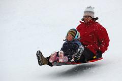 Airborne! (ThinkDyfferent) Tags: snow canada raw d70 michelle alberta sledding banff sled 2008 banffnationalpark canadianrockies