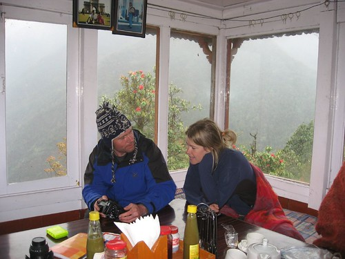 Nancy reviews photos with another trekker in Chomrong