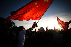 Waving the flag for China (Lil [Kristen Elsby]) Tags: red dawn flag air chinese protest australia wideangle patriotic flashphotography communism demonstration editorial canberra activism patriotism topv3333 topf100 protester act nationalism reportage australasia reconciliationplace oceania demonstrator chineseflag olympictorchrelay documentaryphotography prochinese 2008olympictorchrelay nationalautumnballoonspectacular autumnballoonspectacular gettycurators gettycurator forgettycurators forflickreditorial flickreditorial forflickrvision