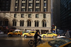 7th Avenue (marktmcn) Tags: taxis bright yellow cabs sunlit sunny sunshine 7th avenue 55th street streets nyc new york city manhattan winter wintry wet cyclist traffic dsc rx 100