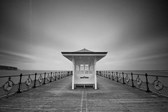 (Claire Hutton) Tags: uk longexposure england sky blackandwhite bw rain clouds pier vanishingpoint movement windy overcast symmetry cliffs dorset boardwalk shelter railings swanage slowshutterspeed ndfilter oldharryrocks swanagepier 10stop nd1000 nd110 bw110 leefilters 03nd 09ndgrad