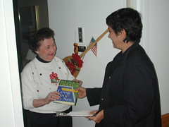 Outreach services staff deliver books to nursing home residents
