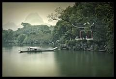 mystic river (biancavanderwerf) Tags: china travel red mountains green water river boat bianca pavillion dreamcatcher reizen paviljoen karstgebergte earthasia