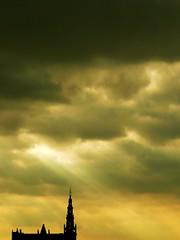 Cloudy Skies (Amaury Henderick) Tags: sun tower silhouette clouds soleil bravo tour belgium belgique toren belgi wolken spire antwerp rays nuages zon antwerpen anvers silhouet stralen teilandje loodswezen tweeduizend godefriduskaai