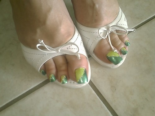 Beautiful summer nail art design. Green nature sexy painted nails design. toe nail art