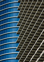 Curves and Lines (Tom Haymes) Tags: city blue windows urban abstract reflection building window glass skyline architecture skyscraper silver buildings downtown texas steel houston symmetry aluminium supershot top20mn enronbuilding exxonbuilding superbmasterpiece onlythebestare houstonbuildings top20texas
