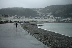 Grey day in Llandudno (harry.1967) Tags: uk wales canon britain gb dogwalker ef50mmf18 andrewlee niftyfifty sooc 400d focusman5 harry1967