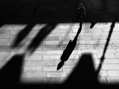 Going it alone (ro_nya) Tags: street shadow bw london walking candid sony southbank nominee ronya goingitalone goldstaraward wwwronyagalkacom worldphotographyawards tpanoir