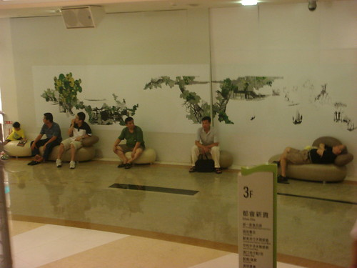 Men waiting at Dream Mall