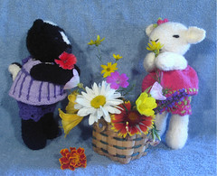 Zoe and Matilde (Poopshe_Bear) Tags: flowers flower toy toys knitting basket handmade knit handknit softies lamb knitted stuffies wicker skunk perennial perennials handknitted poopshebear