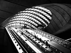 Canary Wharf Underground Station (John D McDonald) Tags: city urban london station sign underground subway geotagged concrete jubilee escalator tube normanfoster docklands londonunderground innercity canarywharf jubileeline eastlondon sirnormanfoster lordfoster fosterandpartners abigfave bwartaward