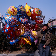 daydreamer (memetic) Tags: china party man 120 6x6 tlr rolleiflex mediumformat balloons asian colorful kodak chinese colourful  e100vs 35e zhejiang   xikou