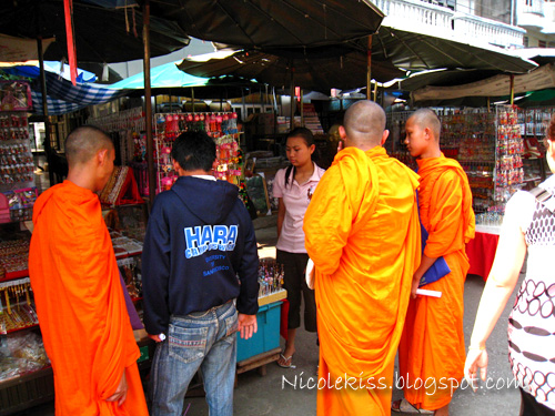 monks shopping for crinkets