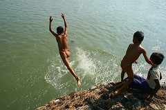 fun time | Murti (arnabchat) Tags: morning india water kids canon river fun kid jump bath tribal splash favs bengal soe decisivemoment murti northbengal dooars 400d shieldofexcellence arnabchat arnabchatterjee