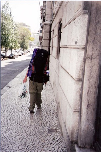 person with backpack walking away