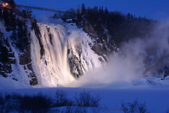 Falls in Quebec city (pfala) Tags: city travel bridge winter snow canada ice night river lights evening nice rocks frost quebec sony hiver riviere freezing falls pont montmorency a100 chutes 1870 falardeau abigfave photoquebec pfala paulfalardeau chutesmontmorrency absolutelystunningscapes fanflickrtastic