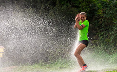 Hitting the wall of water. (Alex-de-Haas) Tags: bootcamp bootcamprun dutch geestmerambacht holland langedijk nederland netherlands noordholland obstaclerun thenetherlands endurance evenement event fit fitness hardlopen joggen jogging modder mud natuurgebied obstacles obstakels overwinnen park recreatie recreatiegebied recreationpark rennen running sport sportief sportiviteit teamspirit