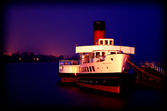 Maid of the Loch (OriginalArnie) Tags: longexposure blue red chimney white black cold reflection water rain night dark lights scotland pier boat ship glow jetty tripod floating rope colourful loch hull idle bows lochlomond funnel afloat alongside moored paddlesteamer maidoftheloch
