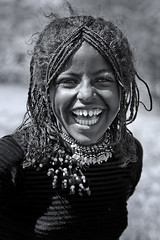 Afar Tribe Girl With Sharpened Teeth, , Danakil, Ethiopia (Eric Lafforgue) Tags: africa girls portrait people blackandwhite smile face smiling vertical laughing photography necklace women day child african decoration culture happiness jewelry tribal innocence bead braids females tradition ethiopia ornate tribe ethnic scar beautifulpeople oneperson frontview confidence traditionalculture adornment hornofafrica ethnology headandshoulders ethiopian afar eastafrica toothysmile braidedhair traditionalclothing realpeople colorimage lookingatcamera statussymbol traveldestination danakil indigenousculture africanculture onegirlonly mg2435 asaita assayta sharpenedteeth africantribalculture