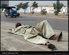 sweet.dreams? (the.serial.chiller) Tags: road street pakistan sleeping man canon graffiti pavement poor streetphotography powershot dreams asleep rickshaw karachi canonpowershot majinnahroad a570 a570is canonpowershota570is canonpowershota570 bunderroad wallchalking