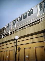 Green Line (Crawford Brian) Tags: cta chicagotransitauthority el elevated train transit silver steel rail embankment concret concrete streetlamp rust chicago oakpark illinois midwest debonair toycamera 120 film lomo