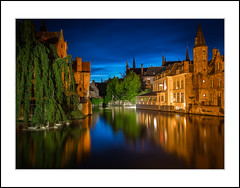 In Bruges (andreassofus) Tags: architecture bruges belgium travel travelphotography water buildings house sky night nightphoto nightphotography reflections mirror swans longexposure color colorful
