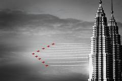 Red Arrows KL Twin towers B&W (lynnpeck1) Tags: kualalumpur raf redarrows petronas twintowers malaysia blackwhite smoketrails