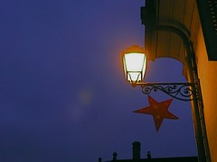 starry night (Vin on the move) Tags: street xmas city blue decorations light red sky urban detail lamp night lumix star switzerland evening town suisse geneve streetlamp decoration essential chirstmas fragment carouge dmctz3 swisspeeks2 iphoto8 vin60