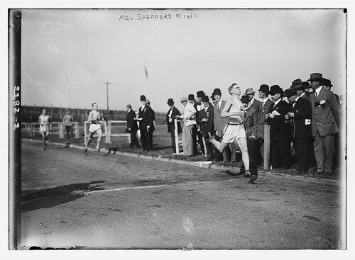 vintage running race with gentlemen onlookers