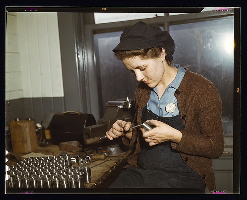 War production workers at the Vilter [Manufacturing] Company making M5 and M7 guns for the U.S. Army, Milwaukee, Wis. Ex-housewife, age 24, filing small parts. Her husband and brother are in the armed service (LOC)