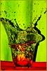 an apple a day... (schoebs) Tags: red macro green apple water contrast sigma splash liquid 150mm goldenmix 40d aplusphoto schoebs