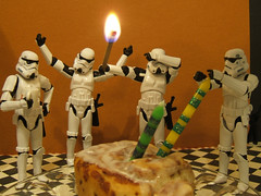 Happy Birthday, Mr. Grimm! (Doctor Beef) Tags: birthday toy actionfigure candles flame stormtrooper match cinnamonroll happybirthdaymrgrimm nostormieswereinjuredormeltedduringthemakingofthisphoto