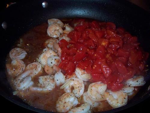 adding tomotoes to shrimp