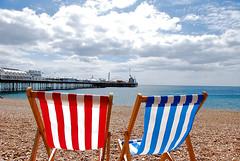 Brighton Beach, England (Mister J Photography) Tags: uk sea england sky beach clouds pier brighton stripes pebble beachchairs