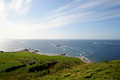 Out to Sea (Mmolnes) Tags: ocean sea summer sky mountain water grass sunshine norway clouds view molnesfjellet